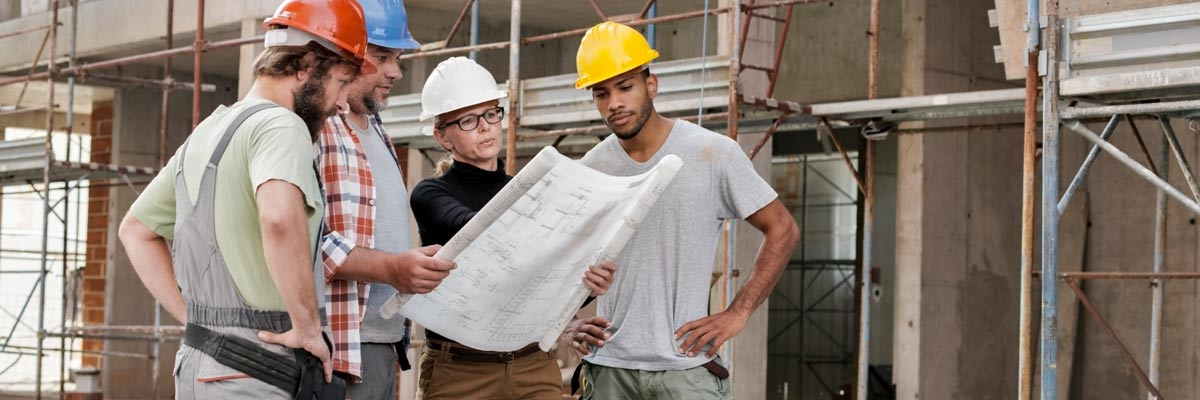 image of architect with construction workers