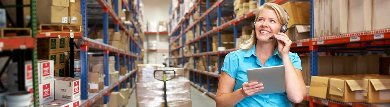 woman with headphones in warehouse