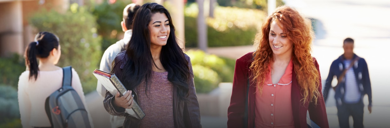 two college women walking on campus