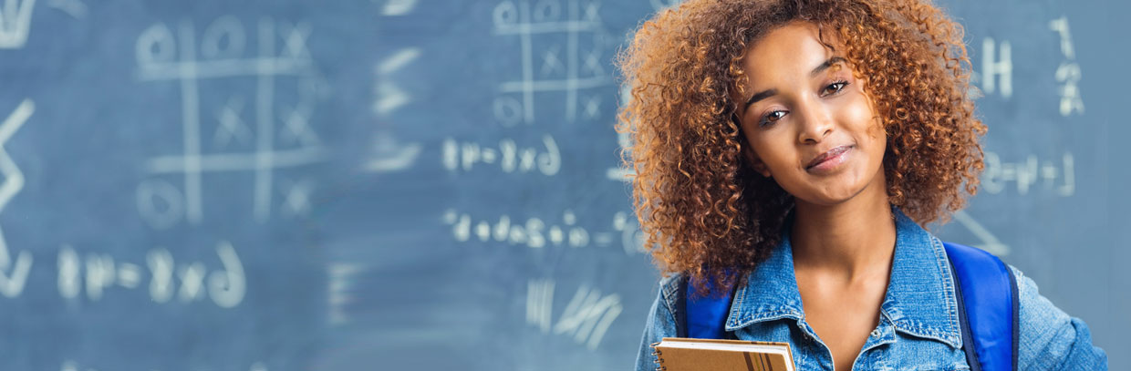 high school girl in front of blackboard